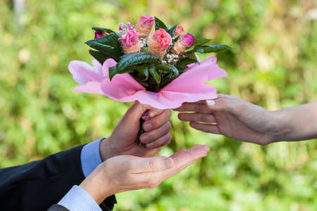 Man with flowers wanted a woman to marry him Stock Photo - 22245830