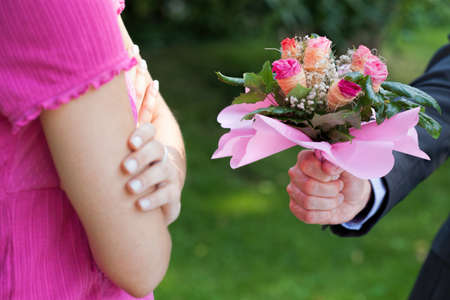lovers quarrel: Man with flowers begging for forgiveness his woman Stock Photo