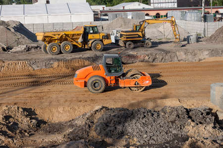 A building site with trucks and excavators photo