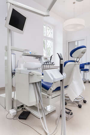 dental clinic: Vertical photo of a dental seat with equipment
