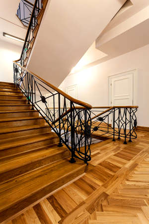 Wooden stairs in elegant classic interior photo