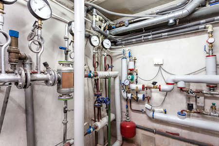 thermodynamic: Pipes in a basement of a heating system Stock Photo