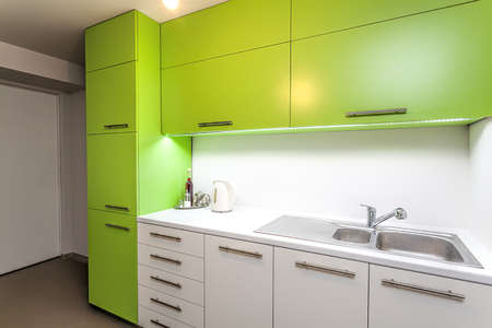 furniture design: Green and white furniture in a modern kitchen interior Stock Photo