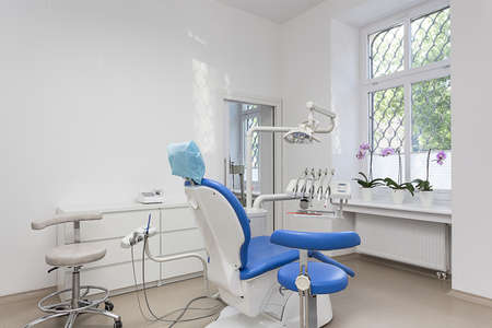 Bright interior of dentist room and seat photo