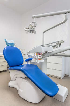 dental tools: Vertical view of a dentist room with blue seat Stock Photo