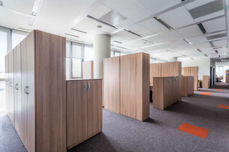 bank interior: Interior of a modern office centre with wooden furniture Stock Photo