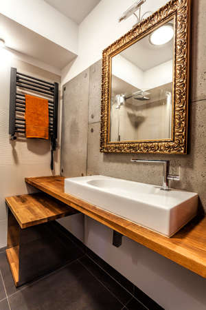 well equipped: Wash basin and elegant mirror in a bathroom