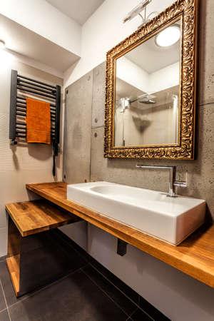 Wash basin and elegant mirror in a bathroom Stock Photo - 22295522