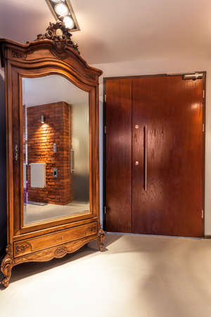 Old original wardrobe with mirror in a corridor Stock Photo - 22295517
