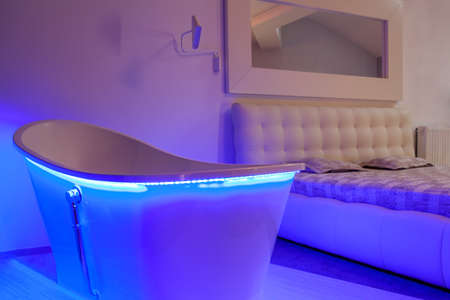 Closeup of a neon bath in a modern bedroom photo