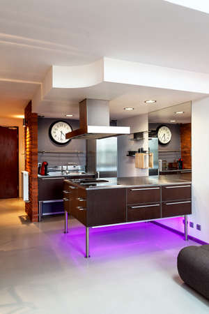 Modern kitchen interior with a brown furniture photo