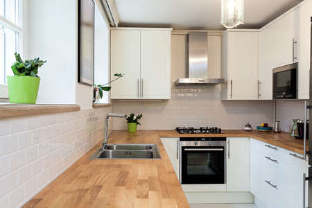 Vintage mansion - a wooden countertop in a white kitchen Stock Photo - 22343726