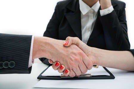 business transaction: Business handshake as a final of a discussion