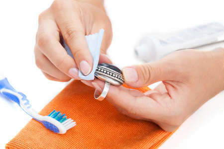 polishing: Professional jewellery cleaning with toothpaste and cleaning rug
