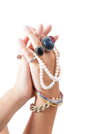 Woman's hands showing jewellery on white isolated background photo