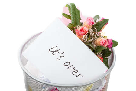ex wife: Roses and its over note in dustbin, white isolated background Stock Photo