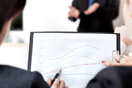 Closuep of business people analyzing a line chart Stock Photo - 22402313