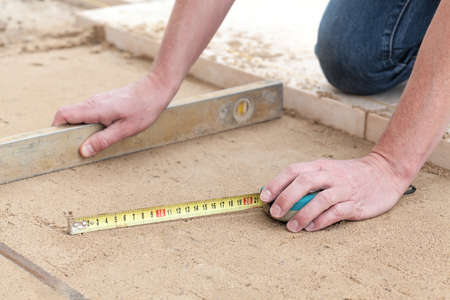 paving stone: Building a terrace with level line and measure