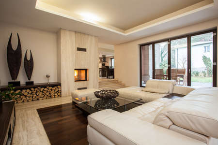 living room design: Travertine house: contemporary living room with fireplace