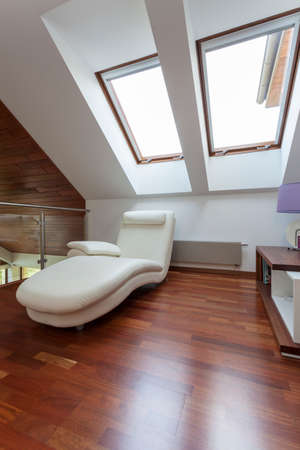 Modern room on the attic with comfortable seat Stock Photo - 22418229