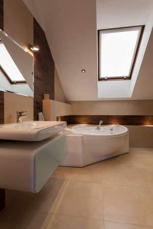Interior of modern bathroom at the attic photo
