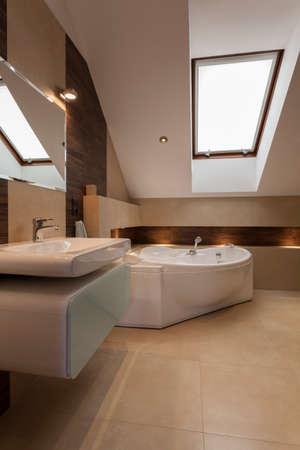 bathroom design: Interior of modern bathroom at the attic