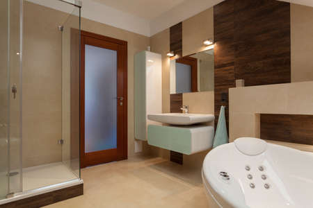 Bathroom with bathtub and a glass shower photo