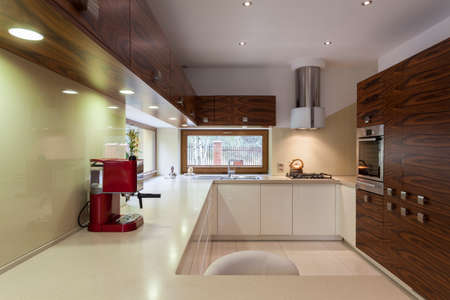 Spacious modern kitchen interior with new appliances photo