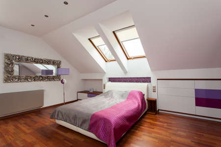 New bedroom with huge bed and purple additions photo