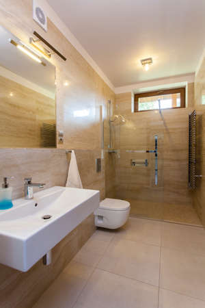 Inter of modern bathroom with travertine walls Stock Photo - 22418242