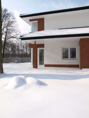 Big contemporary house covered with snow in winter photo