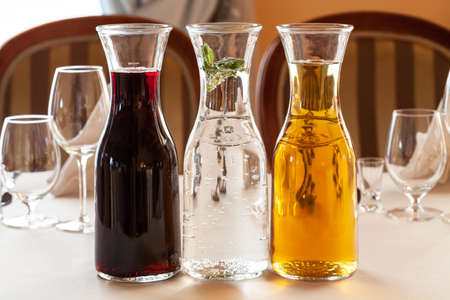 wino: Cherry, apple juices and water on reception table Stock Photo