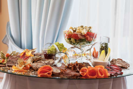 Appetizing food snacks at decorated banquet table photo