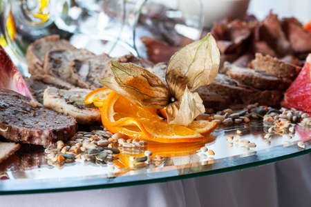 Pie slices and orange decoration on banquet table photo