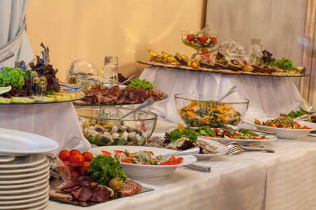 Buffet with different gourmet appetizers for wedding party photo
