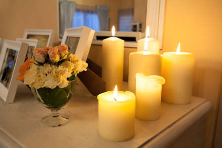 Closeup of a lighted candles on white commode Stock Photo - 22472967