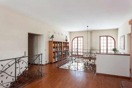 Classy house - Elegant mezzanine with huge bookcase Stock Photo - 22473314