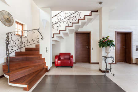 Classy house - Corridor with elegant stairs and armchair Stock Photo - 22473324