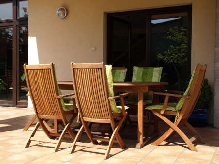 Terrace equipment: wooden table and chairs photo
