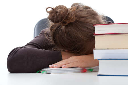 test deadline: Tired student taking a break in learning with the heap of books