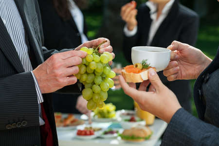 reception table: Lunch break with healthy food in a company