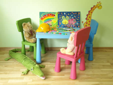 Teddy bears sitting on a chair in children's room photo