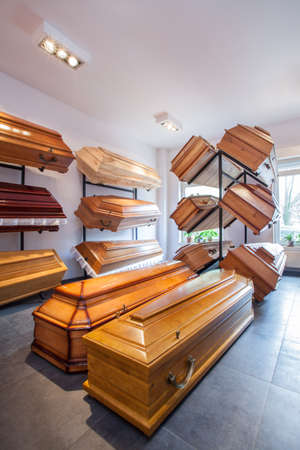 coffins: Wooden brown coffins in a funeral home Stock Photo