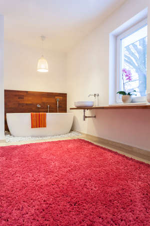Bathroom with a huge pink carpet photo
