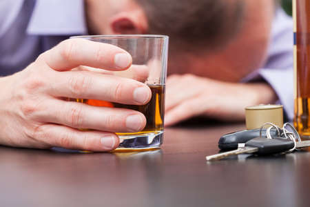 drinking driving: Alcoholic sleeping on the table with car keys