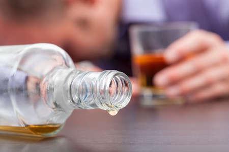 vodka bottle: Uncontrolled consumption of alcohol - alcoholizm disease