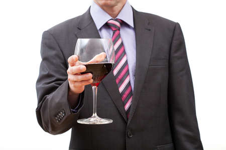 Businessman holding glass of red wine on white isolated background Stock Photo - 22795083