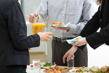 outdoor event: Managers party with colourful food in office