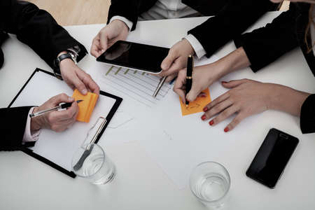 schedule reports: Team of business people on the meeting, chart analysis Stock Photo
