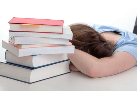 Frustrated student stressed before hard exam taking a break in learning photo